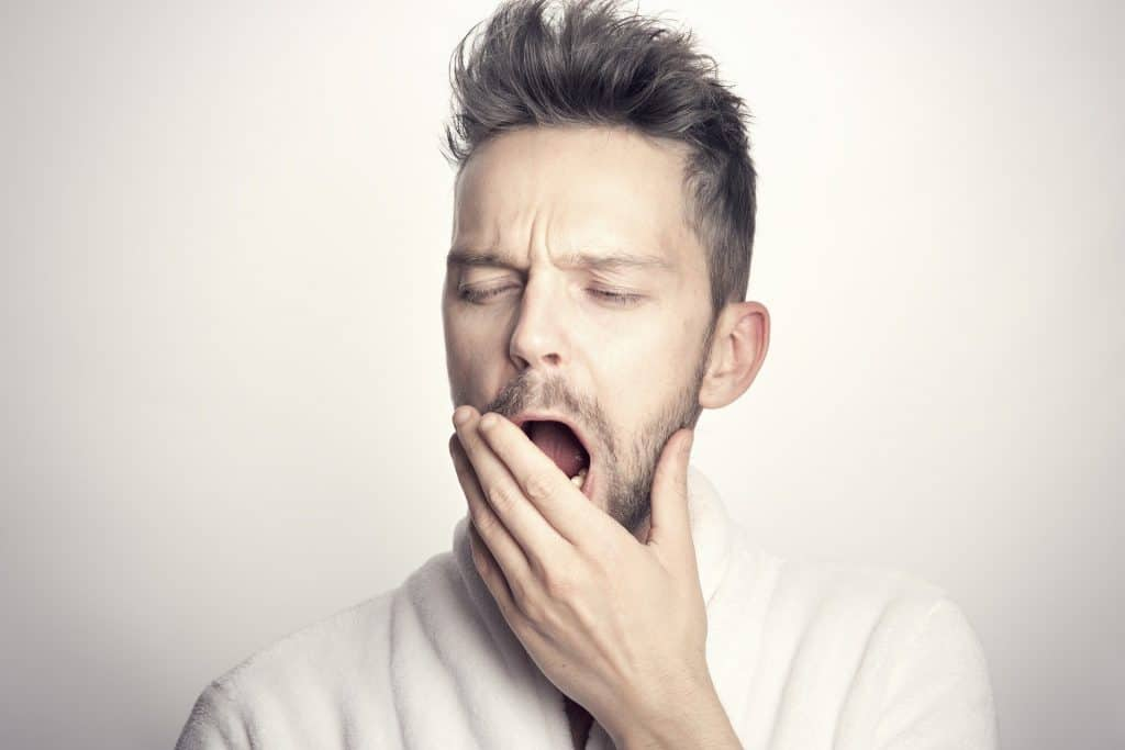 Man yawning after sedation dentistry appointment